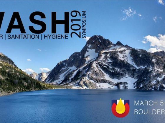 Colorado WASH Symposium banner showing mountains and a lake